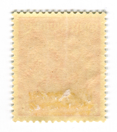 unstuck: The reverse side of a postage stamp.