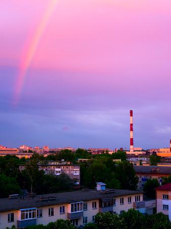 smokestacks: Factory chimneys and rainbow. Stock Photo
