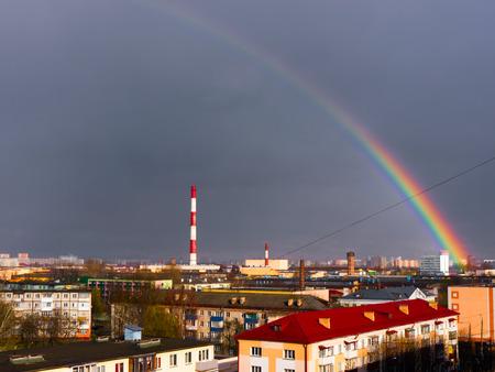 smokestacks: The Factory chimneys and rainbow.