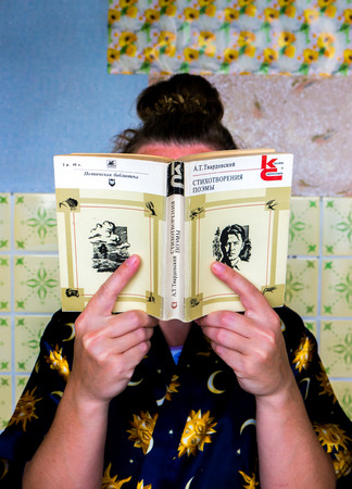 poems: GOMEL, BELARUS - AUGUST 2, 2015: Girl holding a book by Alexander Tvardovsky Poems.