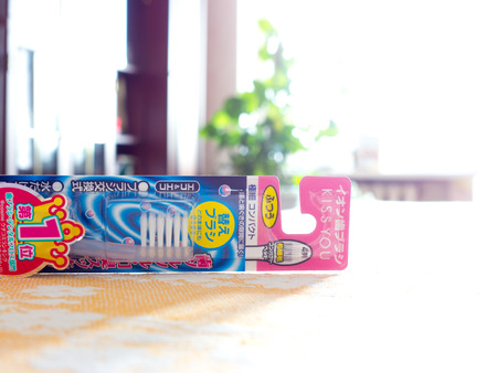 ionic: GOMEL, BELARUS - AUGUST 1, 2015: Japan Cosme Kiss you ionic Toothbrush. Cosme Inc. manufactures and sells OTC pharmaceuticals, oral hygiene products, deodorizing air fresheners.