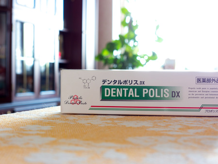 polis: GOMEL, BELARUS - AUGUST 1, 2015: Japanese toothpaste Dental police DX. DENTAL POLIS DX Medicinal toothpaste propolis extract.