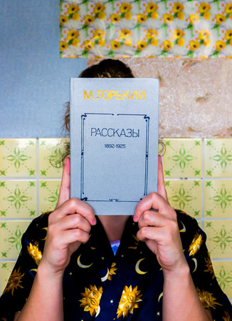 gorky: GOMEL, BELARUS - AUGUST 1, 2015: Girl holding a book by Maxim Gorky Stories. Editorial