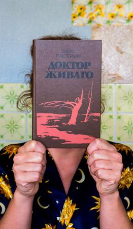 boris: GOMEL, BELARUS - AUGUST 1, 2015: Girl holding a book by Boris Pasternak Doctor Zhivago. Editorial