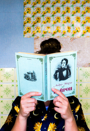 byron: GOMEL, BELARUS - AUGUST 2, 2015: Girl holding a book by Andre Morua Byron.
