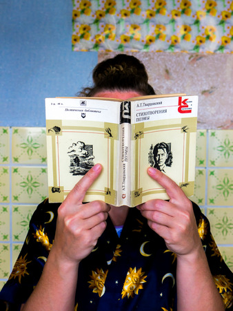 poems: GOMEL, BELARUS - AUGUST 2, 2015: Girl holding a book by Alexander Tvardovsky Poems.