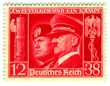 adolf hitler: GOMEL,BELARUS - FEBRUARY 2016: A stamp printed in Germany shows image of the Benito Amilcare Andrea Mussolini and Adolf Hitler, circa 1942.