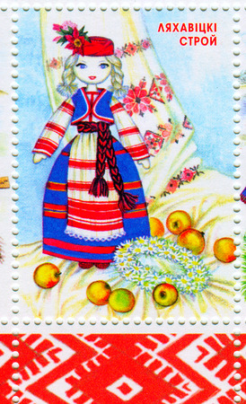 A stamp printed in BELARUS shows image of the dedicated to the Belarusian national clothes, circa 2012. Editorial