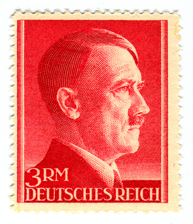 adolf hitler: A stamp printed in GERMANY shows image of the Adolf Hitler (20 April 1889 - 30 April 1945) was an Austrian-born German politician who was the leader of the Nazi Party (NSDAP), Chancellor of Germany from 1933 to 1945, and F�hrer (leader) of Nazi Germany  Editorial