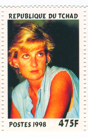 lady diana: A stamp printed in Chad shows image of the Diana, Princess of Wales (1 July 1961 - 31 August 1997), was the first wife of Charles, Prince of Wales, who is the eldest child and heir apparent of Queen Elizabeth II, circa 1998.