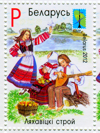 dedicated: A stamp printed in BELARUS shows image of the dedicated to the Belarusian national clothes, circa 2012. Editorial