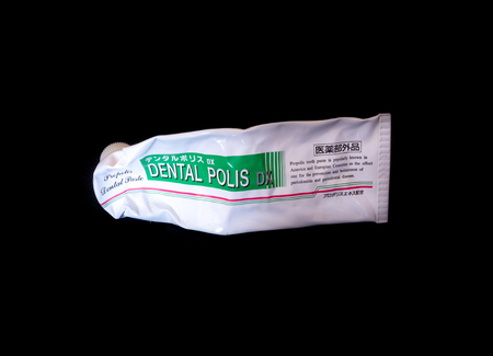 polis: GOMEL, BELARUS - APRIL 17, 2016:Japanese toothpaste Dental police DX. DENTAL POLIS DX Medicinal toothpaste propolis extract.