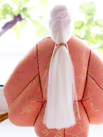 GOMEL, BELARUS - MAY 24, 2015: The Antique Kimekomi Japanese doll old woman Uba depicting a Noh play, The Old Couple from Takasago. Japanese traditional dolls are known by the name ningyo in Japan, which literally means human shape.