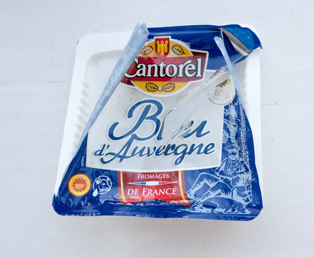 cheez: GOMEL, BELARUS - MAY 07, 2016: Cantorel Cheese Bleu dAuvergne with blue mold. Brand Cantorel is part of the Les Fromageries Occitanes (Provencal cheese factory), which is a major player among French producers of cheeses.
