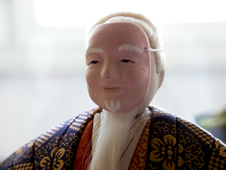 noh: GOMEL, BELARUS - MAY 24, 2015: The Antique Kimekomi Japanese doll old man Jo depicting a Noh play, The Old Couple from Takasago. Japanese traditional dolls are known by the name ningyo in Japan, which literally means human shape. Editorial