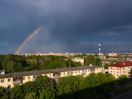 smokestacks: The city outdoor Factory chimneys and rainbow. Stock Photo