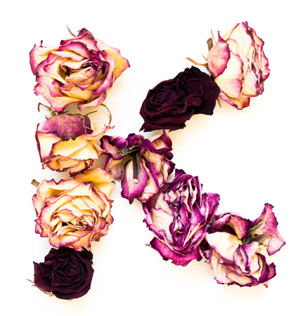 initials: Rose dried Initials letter K. Stock Photo