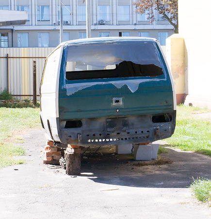 headquartered: GOMEL, BELARUS - SEPTEMBER 6, 2016: Old Grunge Rusty Volkswagen Van. Volkswagen  is a German automaker, headquartered in Wolfsburg, Germany. Editorial