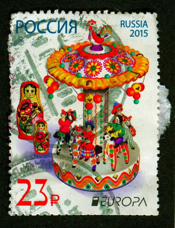 nesting: GOMEL, BELARUS, 1 FEBRUARY 2017, Stamp printed in Russia shows image of the matryoshka doll, also known as a Russian nesting doll, is a set of wooden dolls of decreasing size placed one inside another, circa 2015. Editorial