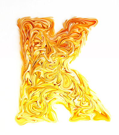 The yellow candy letter K.