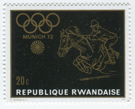 GOMEL, BELARUS, APRIL 5, 2017. Stamp printed in Rwanda shows image of  The 1972 Summer Olympics, officially known as the Games of the XX Olympiad, was an international multi-sport event held in Munich, West Germany, from August 26 to September 11, 1972, c Editorial