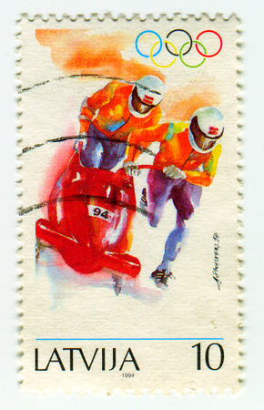 bobsled: GOMEL, BELARUS, APRIL 5, 2017. Stamp printed in Latvia shows image of  The bobsled, circa 1994. Editorial