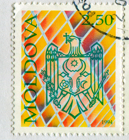 GOMEL, BELARUS, APRIL 7, 2017. Stamp printed in Moldova shows image of  The coat of arms Moldova, circa 1994. Editorial