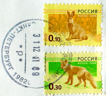 GOMEL, BELARUS, APRIL 13, 2017. Stamp printed in Russia shows image of  The Lepus europaeus and fox, circa 2008.
