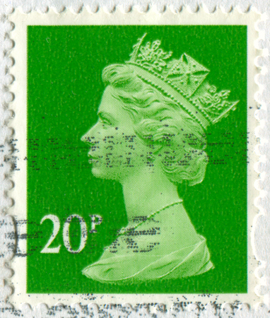 torn: GOMEL, BELARUS, APRIL 18, 2017. Stamp printed in UK shows image of  The Elizabeth II has been Queen of the United Kingdom, Canada, Australia, and New Zealand, circa 2000. Editorial