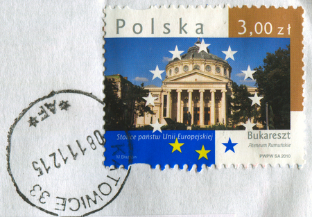 GOMEL, BELARUS, APRIL 21, 2017. Stamp printed in Poland shows image of  The Romanian Athenaeum is a concert hall in the center of Bucharest, Romania, circa 2010. Editorial
