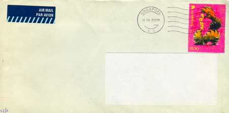 old envelope: GOMEL, BELARUS - AUGUST 12, 2017: Old envelope which was dispatched from Singapore to Gomel, Belarus, August 12, 2017.