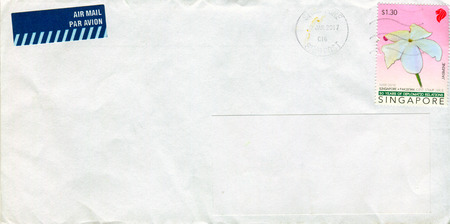 GOMEL, BELARUS - AUGUST 12, 2017: Old envelope which was dispatched from Singapore to Gomel, Belarus, August 12, 2017.