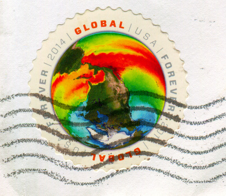 GOMEL, BELARUS, 27 NOVEMBER 2017, Stamp printed in USA shows image of the Earth, circa 2014.