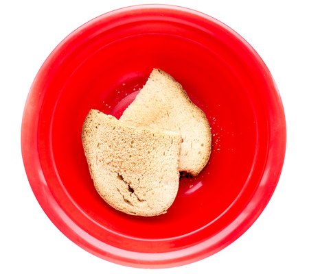 Dry Stale bread on a red plate.