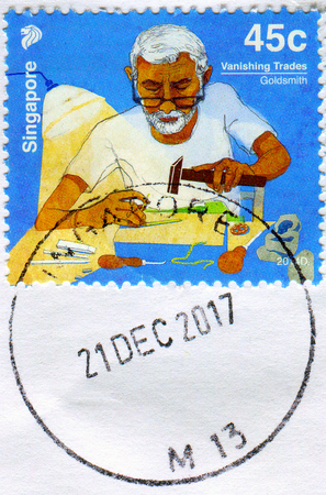 GOMEL, BELARUS, 3 DECEMBER 2017, Stamp printed in Singapore shows image of the Goldsmith, circa 2017. Éditoriale
