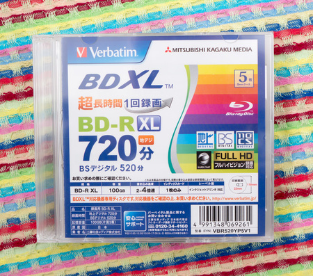GOMEL, BELARUS - MAY 30, 2018: Mitsubishi (Verbatim) BD-R XL 100GB disc on a variocolor background. The Mitsubishi Group is a group of autonomous Japanese multinational companies.