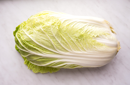Cabbage isolated on a marble background.