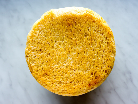 The Bread on a marble background. Stock Photo