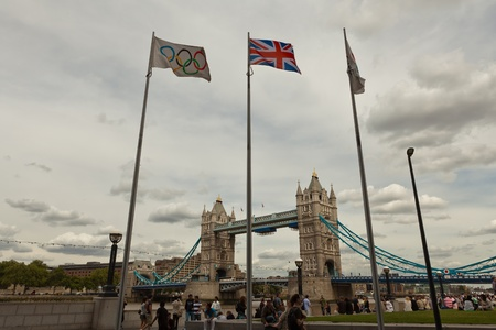 olympic ring: London, UK, July 2010 - Olympic & British flags in front of Tower Bridge
