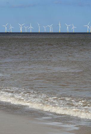 Wind farm at sea Stock Photo