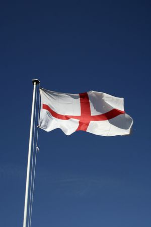Flag of St George against a blue sky Stock Photo - 7285171