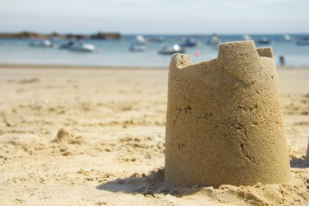 Sandcastle and harbour photo