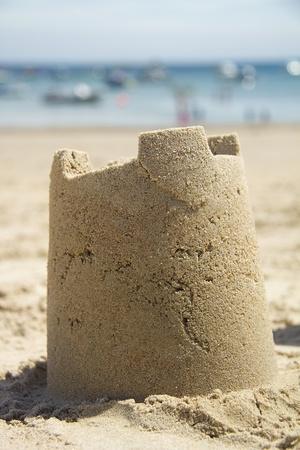 Sandcastle and sea Stock Photo