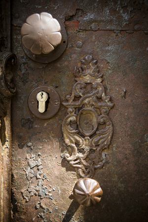 weathered: Weathered and rusty doorknobs and lock Stock Photo