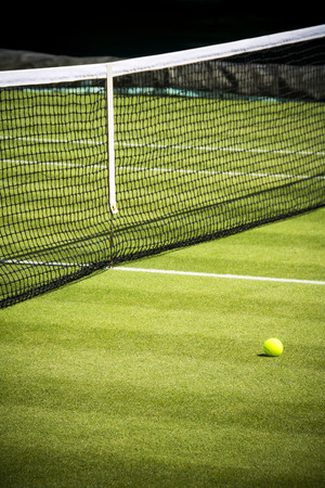 Tennis court and ball on sunny day Stock Photo