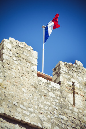 tricolour: French tricolour flag on medieval ramparts