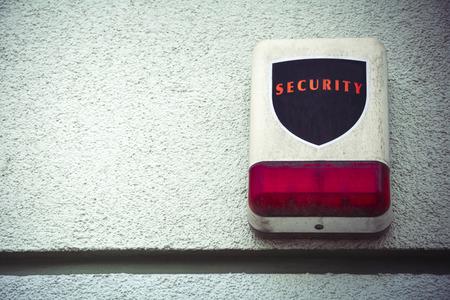 wall mounted: Wall mounted burglar alarm on outside wall Stock Photo