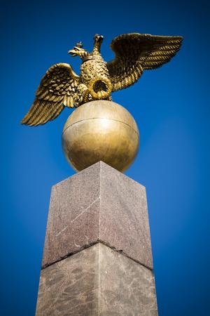double headed: Doubled headed eagle atop red granite obelisk in Helsinki