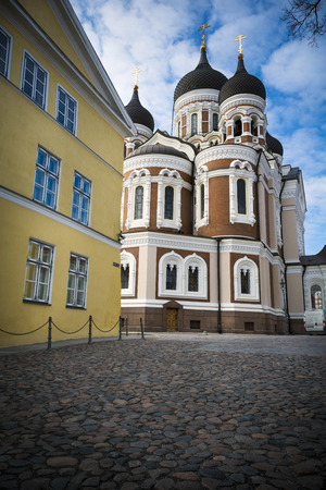 Tallinn orthodox cathedral by cobblestones in medieval old town Stock Photo