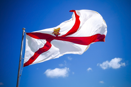 Channel Islands Jersey flag against blue sky